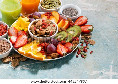 fresh seasonal fruits, juices and super foods and blue vintage background, horizontal - stock photo