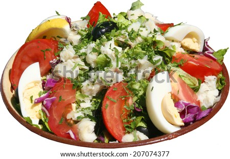 Fresh seasoned salad with vegetables, eggs, tomatoes and herbs. Prepared with onions, cheese, tuna fish and cabbage. Green leaf lettuce in background. - stock photo