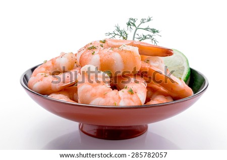 Fresh shrimp are a delicious gourmet appetizer on white background. - stock photo