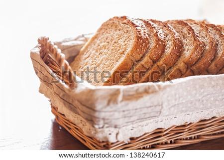Fresh sliced bread in a wicker basket - stock photo