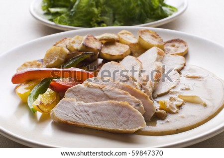 Fresh sliced chicken with roasted potato and pepper close up - stock photo