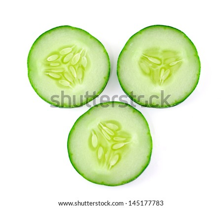 Fresh sliced cucumber on white background - stock photo