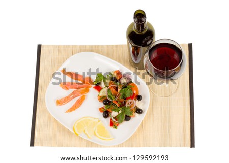 Fresh sliced salmonserved with a mixed salad and glas of red wine - stock photo