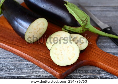Fresh slices of chopped �¢??�¢??eggplant on cutting board - stock photo