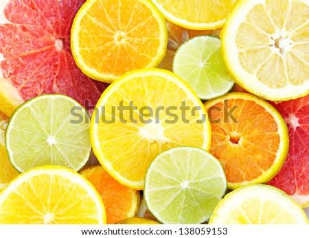 Fresh slices of different types of citrus: Orange, lime,Mandarin,Grapefruit - stock photo