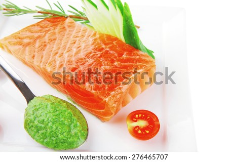 fresh smoked red fish fillet on plate and sauce - stock photo