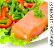 fresh smoked salmon fillet with vegetables - stock photo