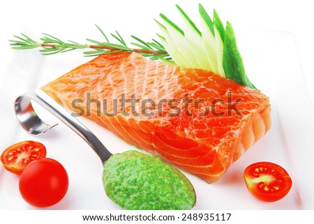 fresh smoked salmon fillet with vegetables and sauce - stock photo
