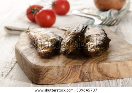 fresh smoked vendace on a wooden board - stock photo