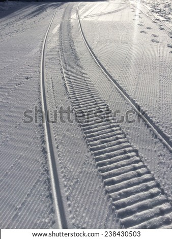 Fresh snow groomer tracks on a ski resort - stock photo