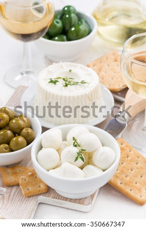 fresh soft cheeses, crackers and pickles to wine, top view, vertical - stock photo