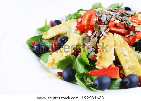 Fresh spinach salad with goat cheese and  seeds - stock photo