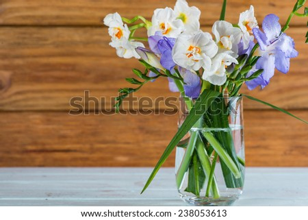 fresh spring daffodil in glass on table - stock photo