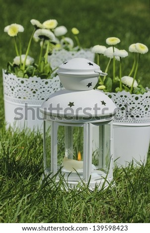 Fresh spring decorations for the First Communion, or First Holy Communion, a Catholic Church ceremony. Symbol of innocence. - stock photo
