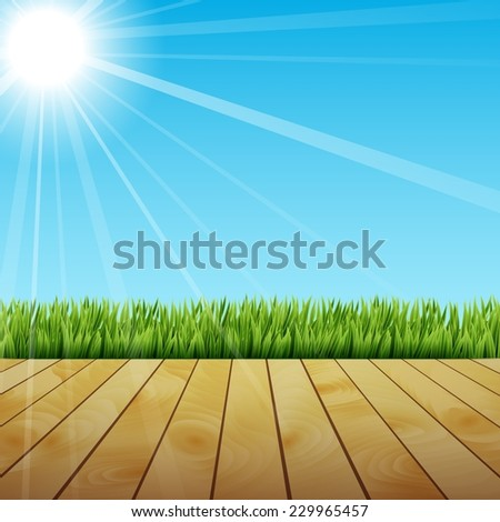 Fresh spring green grass with sunlight and wooden floor - stock photo
