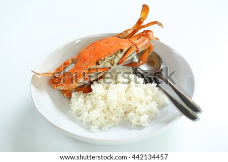 Fresh steamed blue swimmer crab with rice in white dish. - stock photo