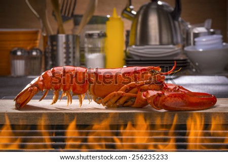 Fresh Steamed Lobster with Lemon, Fresh Vegetables and Barbecue Grill  - stock photo