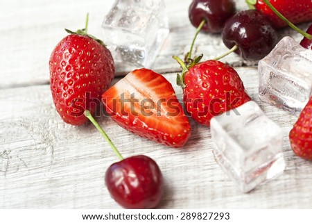 Fresh strawberries and cherries - stock photo