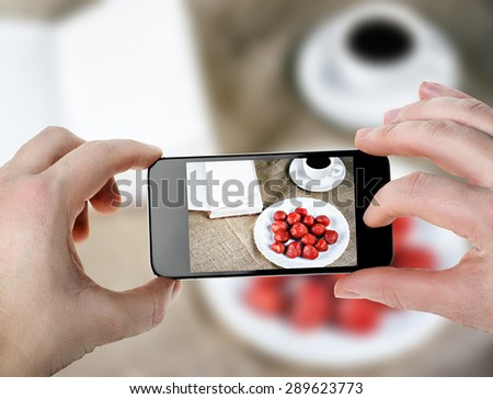 Fresh strawberries and coffee - the smartphone photo - stock photo
