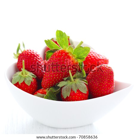 Fresh strawberries in bowl isolated on white background - stock photo
