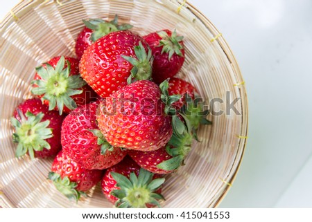 fresh strawberries in wood basket - stock photo