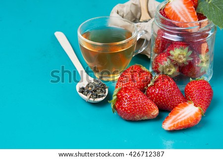 fresh strawberries on a bright background. Fruit tea with strawberries on a wooden spoon.  Food Frame Background with space for advertising text. soft selective focus Photo - stock photo