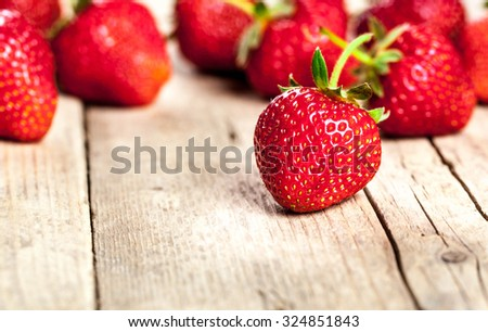 Fresh strawberries on a wooden background. fruit - stock photo