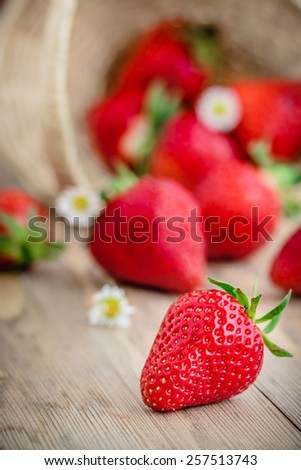 Fresh strawberries on wooden table. Selective focus. - stock photo