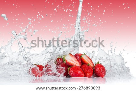 Fresh Strawberries with water splash over white background - stock photo