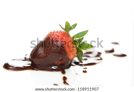 Fresh strawberry covered in dark chocolate over white background. - stock photo