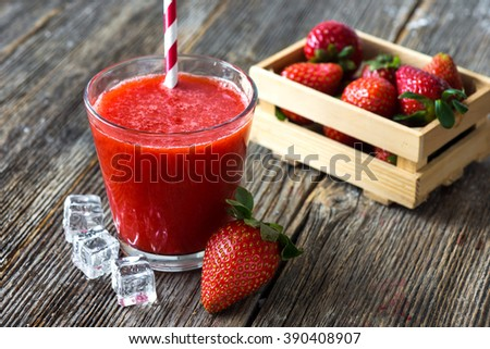 Fresh strawberry drink on wood background - stock photo