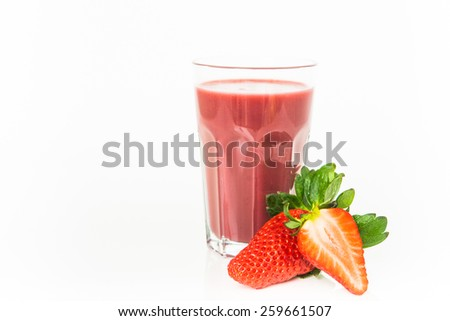Fresh strawberry fruits and smoothies on white - stock photo