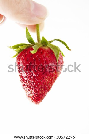 fresh strawberry in hand on a white background - stock photo