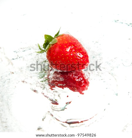 Fresh strawberry in water splash - stock photo