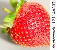 Fresh strawberry isolated on grey background - stock photo