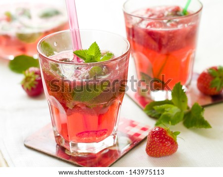 Fresh strawberry mojito or lemonade with mint, selective focus - stock photo