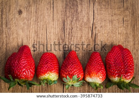 Fresh strawberry on wooden background. Summer ripe strawberry. Flat lay, top view - stock photo