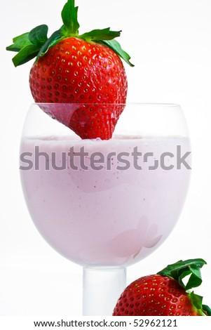 Fresh strawberry smoothie with ripe,plump strawberry garnish. - stock photo