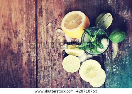 fresh summer cocktail mojito on a wooden table - stock photo