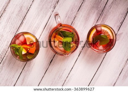 Fresh summer cocktail with fruits over white wooden table. Top view. Selective focus - stock photo