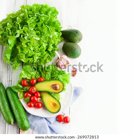 Fresh summer vegetables on white wooden background, top view - stock photo