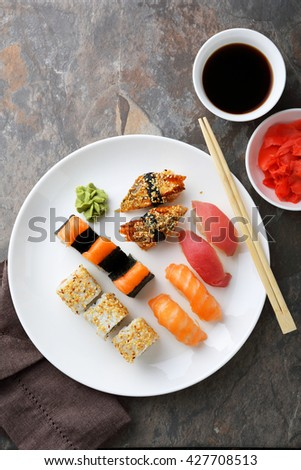 fresh sushi on big plate top view, japan food - stock photo