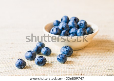 Fresh sweet blueberry fruit. Dessert healthy food. Group of ripe blue juicy organic berries. Raw summer diet. Delicious nature vegetarian ingredient. Wooden background. - stock photo