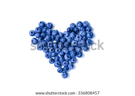 Fresh sweet blueberry fruit heart shape. Dessert healthy food. Group of ripe blue juisy organic berries. Raw summer diet. Delicious nature vegetarian ingredient. Isolated on white background. - stock photo