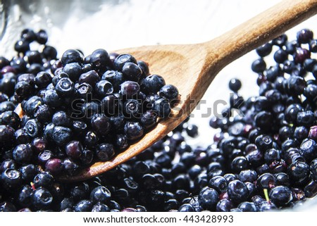 Fresh sweet blueberry fruit in wooden spoon. Dessert healthy food. Group of ripe blue juicy organic berries. Raw summer diet. Delicious nature vegetarian ingredient - stock photo