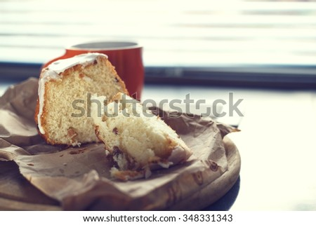 Fresh sweet bread and a cup of coffee for breakfast in the morning. Cup of tea. Toned image. Traditional cake. Concept - breakfast, morning, sun light, fresh cakes, happiness, delicious smell. - stock photo