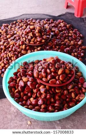 Fresh sweet chestnuts in market - stock photo
