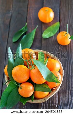 fresh tangerines, tangerines on the wooden table - stock photo