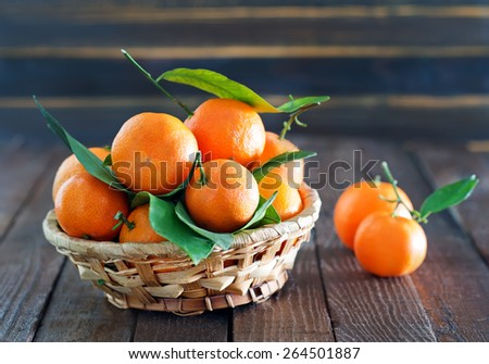 fresh tangerines, tangerines on the wooden table - stock photo
