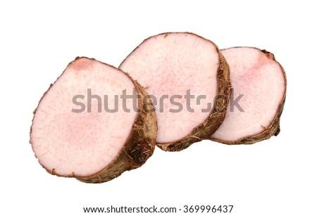 Fresh taro root cut in slice over white background - stock photo